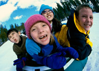 Photo: Group of young boys sledding