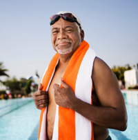 Photo: Senior man by swimming pool