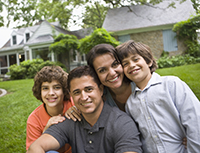 Photo: Young Hispanic family smiling