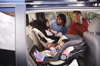 Photo: Baby and child in car seat.