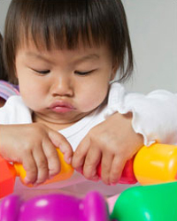 Photo: A girl playing with toys.