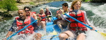 Photo: A group of people white water rafting.
