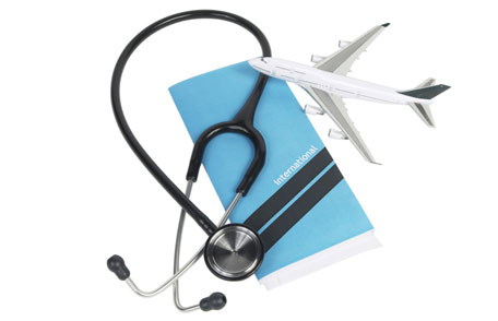 Passport, stethoscope and toy plane