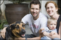 Photo: A family with their dog.