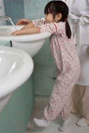 Photo: A girl washing her hands