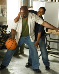 Photo: Father and son playing basketball