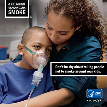 A mother holding a boy with an oxygen mask, don't be afraid to tell people to not smoke around your kids