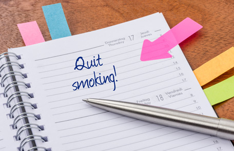 Notepad with quit smoking written on it
