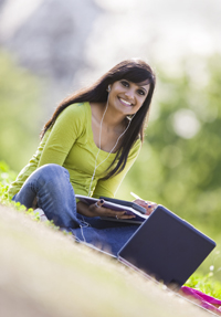 Photo: Female college student holding books