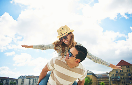 A picture of a young couple having fun on vacation. Remember, what happens abroad may not always stay abroad.  You can take steps to prevent the risk of STDs when you travel.