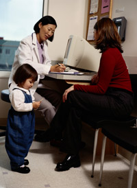 Photo: Doctor talking to mother and child