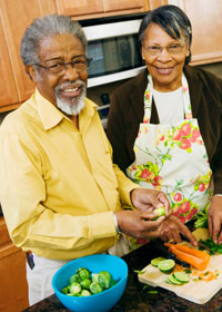 Photo: Senior couple making healthy dinner