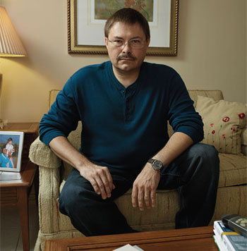 Tips From Former Smokers® campaign participant Mark, sitting on a couch at his home and looking directly into the camera.