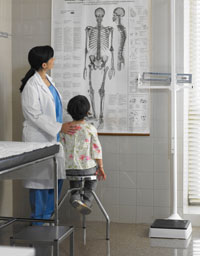 Doctor showing young patient chart of anatomy