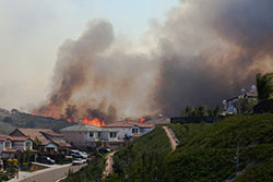 Wildfires burning near residential area
