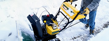 Photo: A person using a snow thrower.