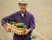 Photo: Rural Farmer holding basket of vegetables