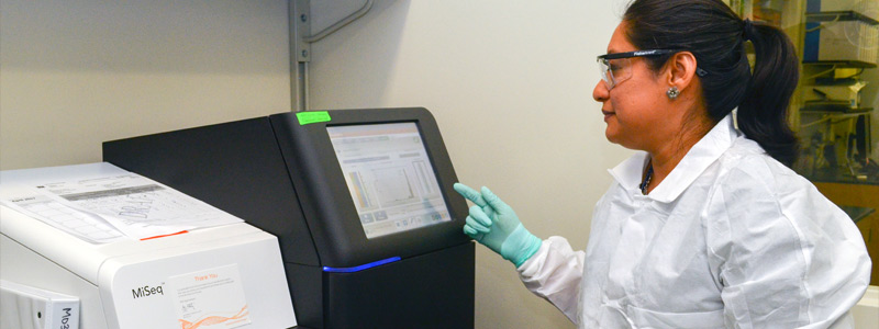 A Laboratory Leadership Service fellow operates a next generation sequencer instrument in a CDC streptococcus laboratory. Atlanta, GA (2017)