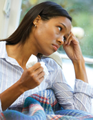 Ask the sick person, like this woman, to use a tissue to cover coughs and sneezes.