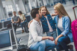 a family with their child ready to board a plane