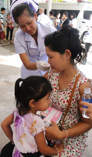 In Laos, a pregnant woman receives her seasonal flu shot.