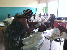 During training, staff at a sentinel site learn the protocol for collecting a respiratory specimen. Democratic Republic of Congo.