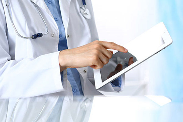 healthcare professional using tablet