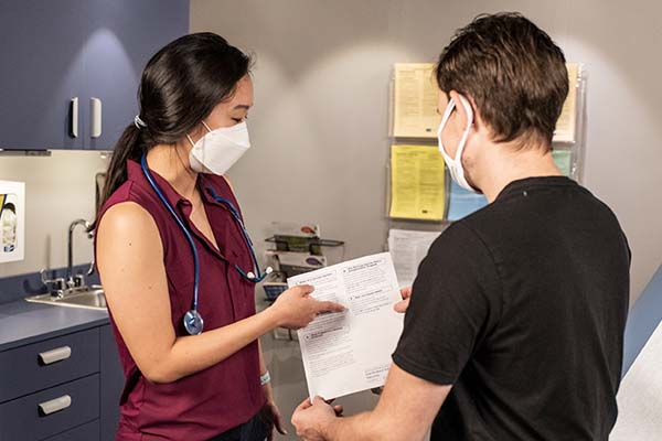 Doctor discussing flu shot with patient