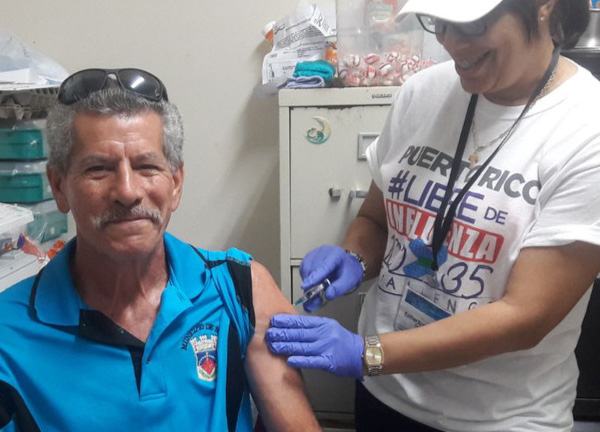 VOCES picture of man getting flu shot