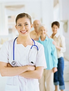 Photo of a female nurse providing care in a long-term care facility.