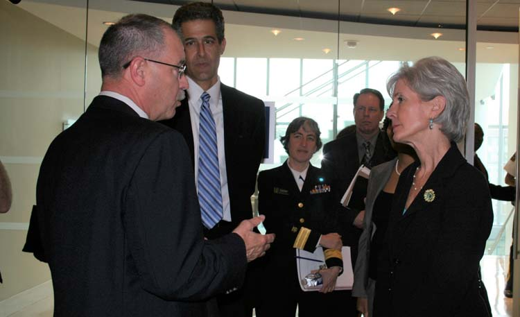 Former Secretary of Health and Human Services Kathleen Sebelius, right, tours CDC's Emergency Operations Center