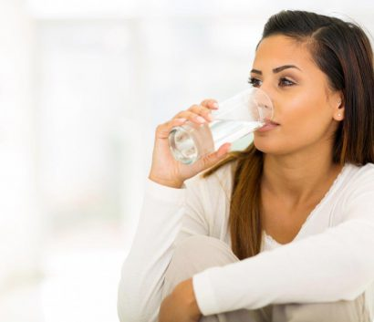 woman drinking fluoridated water