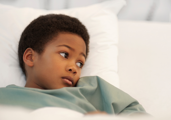 Boy sick in hospial bed