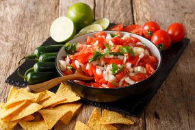 Mexican Pico de Gallo with ingredients closeup and nachos