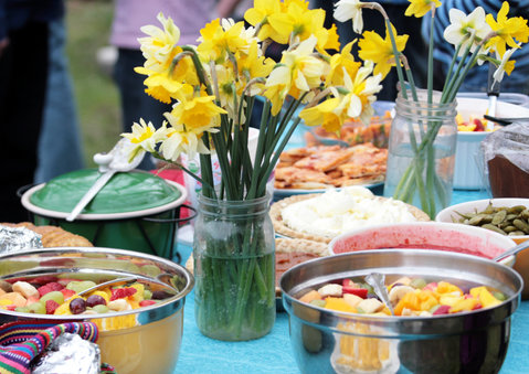 Picnic table with flowers and food