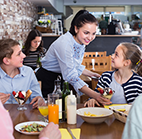 waitress and family in restaurant
