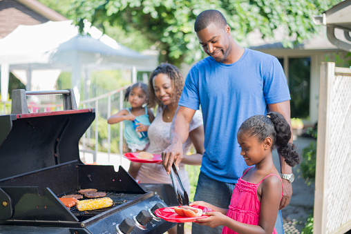 Image of a family cooking on the grill