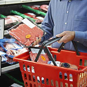 Shopper selecting package meat.