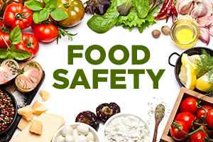 The words Food Safety surrounded by various vegetables