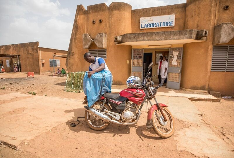 A new system for collecting and delivering lab samples using Burkina Faso's national postal service adds crucial reliability and data that public health leaders can use to better pinpoint trends, outbreaks, and actions. (Source: Evelyn Hockstein, CDC Foundation)