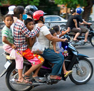 Image of Cambodians on the motorcycles