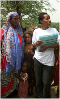 Health worker with women and girls