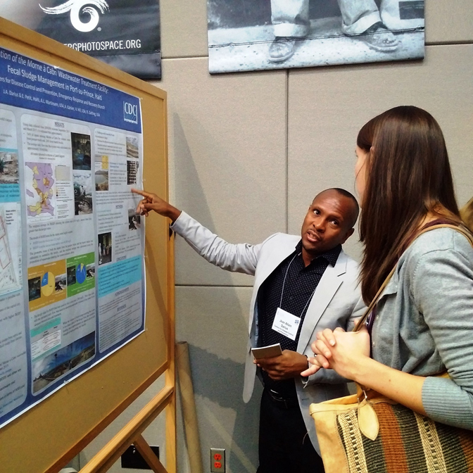 CDC Haiti WASH Advisor, Jean Allain Darius, presenting a poster at the University of North Carolina on CDC's work to evaluate Morne a Cabri wastewater treatment facility, the only functioning fecal sludge disposal site in Haiti.