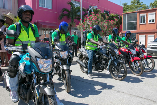 The relaunching of the National Specimen Referral Network, in Port-au-Prince, Haiti, included the presentation of new motorcycles for the efficient transportation of specimens across all ten departments. Photo cred:  US Embassy-Haiti