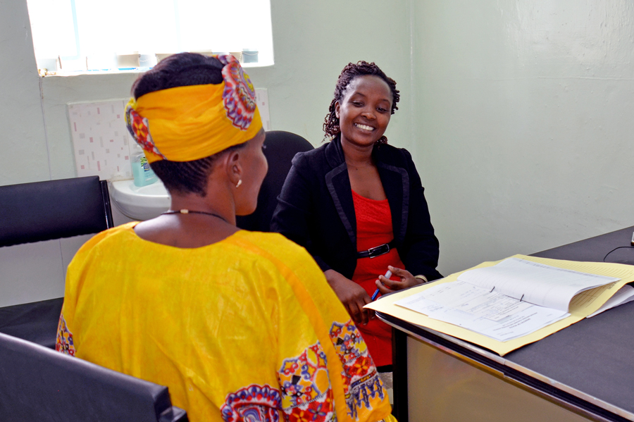 Dr. Mercy Karanja meets with Rosemary to discuss her treatment.