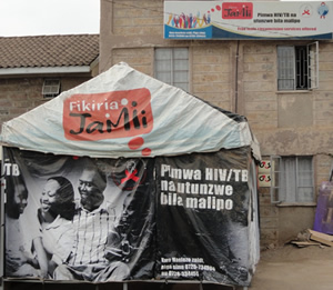 Signs outside Komarock Clinic, in Nairobi, Kenya, let the community know they can be tested and treated for HIV and TB.