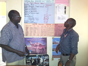 Dr. Chris Ajele (left), shares some local livestock statistics with CDC Kenya GIS Specialist Daniel Macharia (rt)