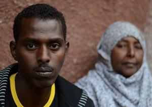 Mohamed, age 25, with his mother, Amina. His mother has been a refugee since 1991 and raised her two children in refugee camps