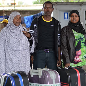 Amina with her two children Mohamed and Sundes. 12 years after fleeing her homeland of Somalia, she is finally going to put down roots and settle into a permanent home.