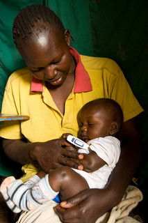 A young mother in the Kibera informal settlement in Nairobi is interviewed by a community interviewer as part of ongoing IEIP research by CDC-Kenya. The information gathered from these regular visits helps the CDC to track potential outbreaks of disease in the crowded and unsanitary settlement. © David Synder